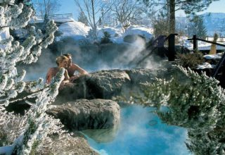 Couple on a steamy outdoor hot tub on a winter day