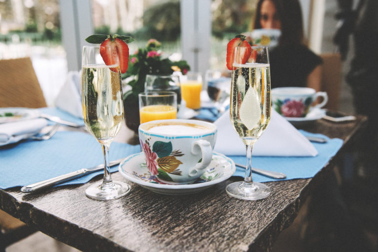 Cup of hot chocolate and champagne glasses on table
