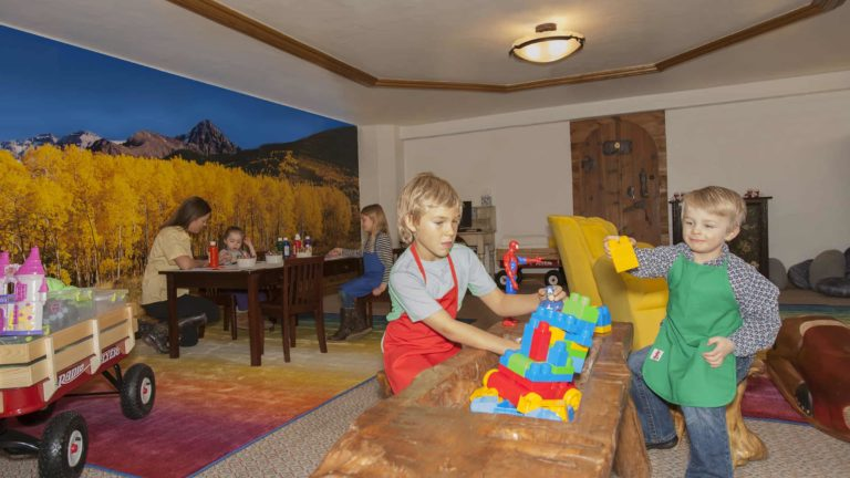 children playing with building blocks in room