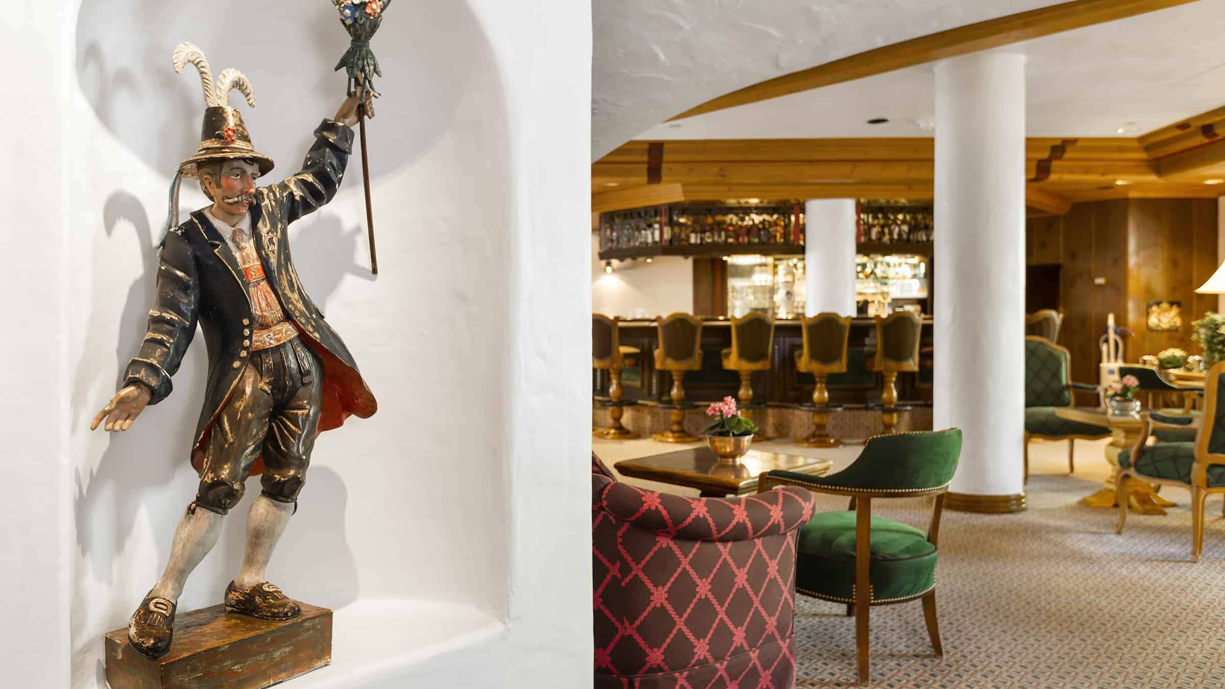 statue on recessed dsplay area on wall, and view of bar in the background