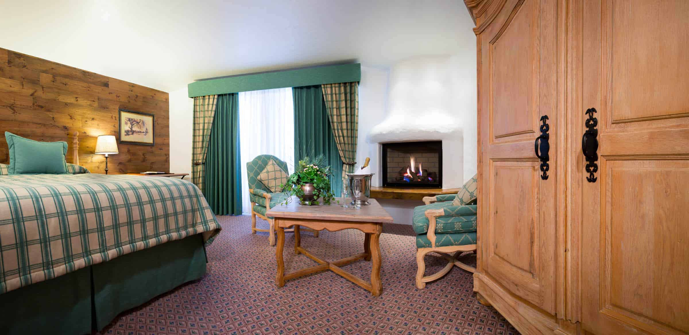 lodgepole jr suite with bed, chairs, table, and large dresser