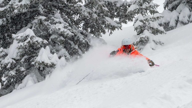 Skier carving snow in Vail