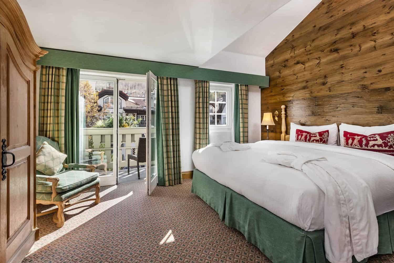 Juniper Hotel Room with bed, dresser, and open door leading to balcony