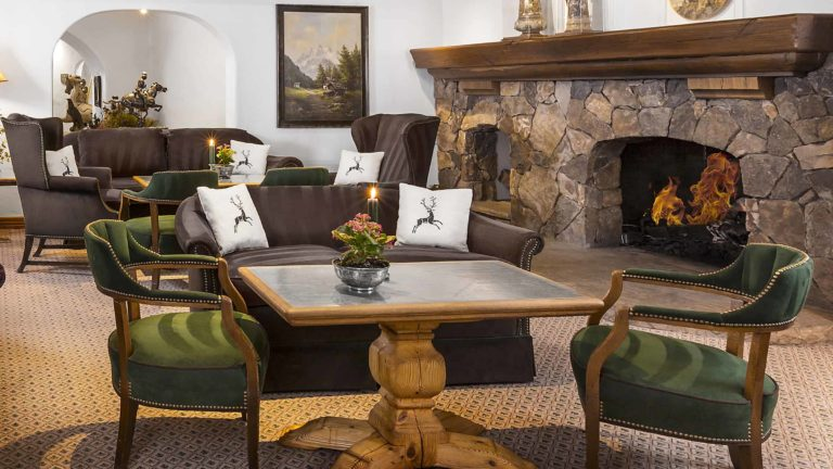 lounge with fireplaces, tables, chairs, sofas, and seating areas