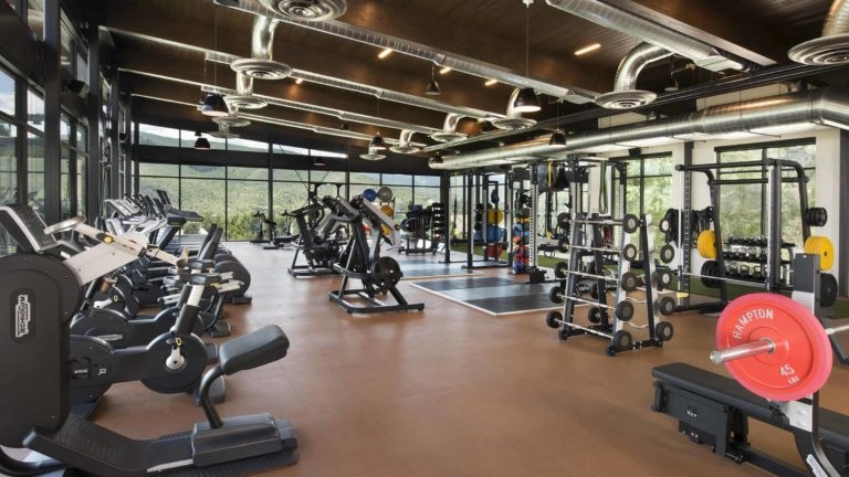 fitness center with weights and gym equipment