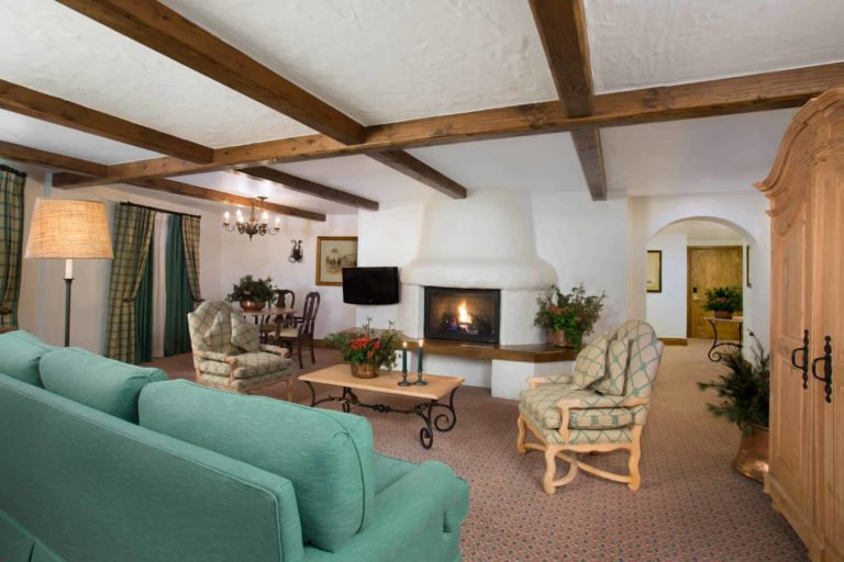 living room suite with fireplace, sofa, chairs, and coffee table
