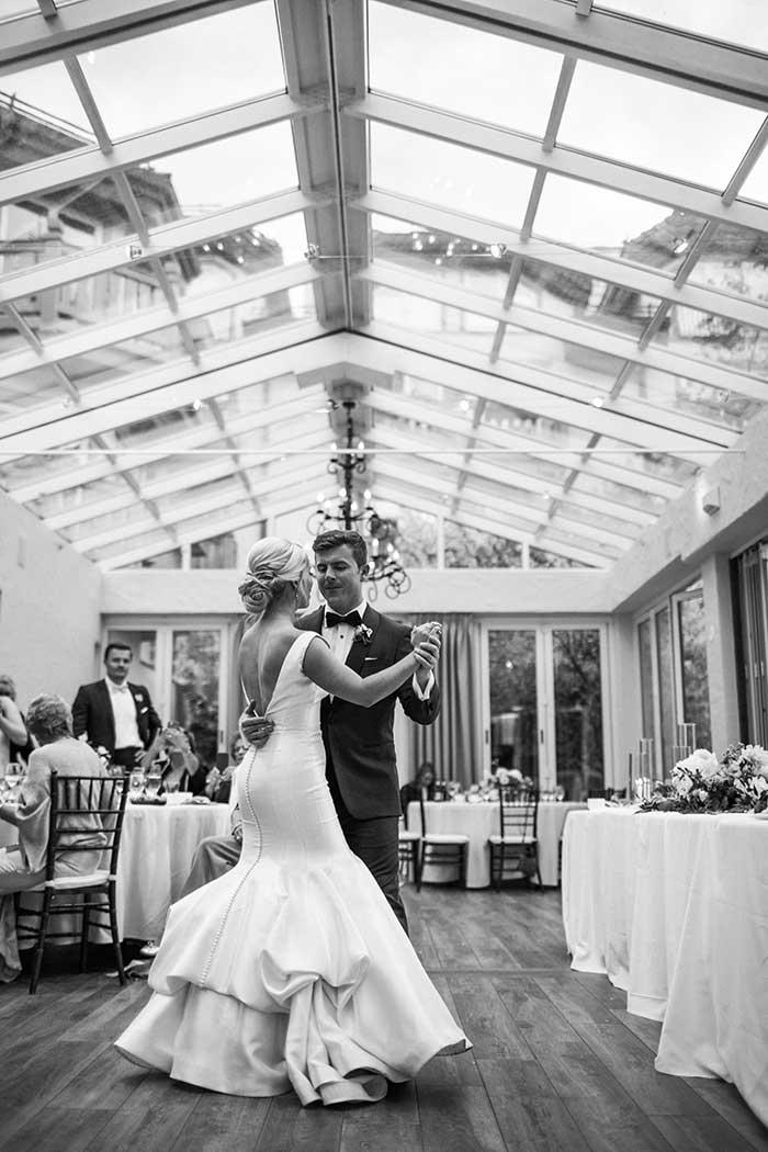 Bride and groom dancing at indoor reception area
