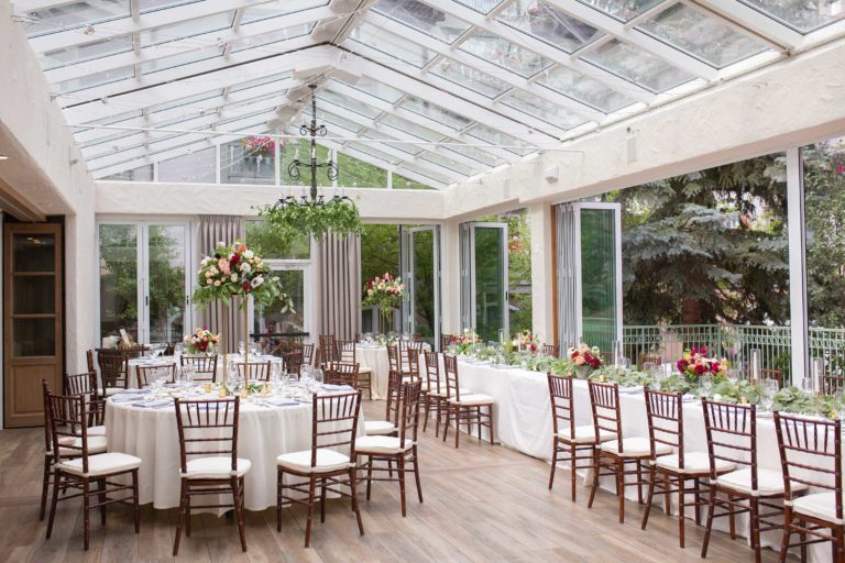 Reception area with tables, chairs, and centerpieces
