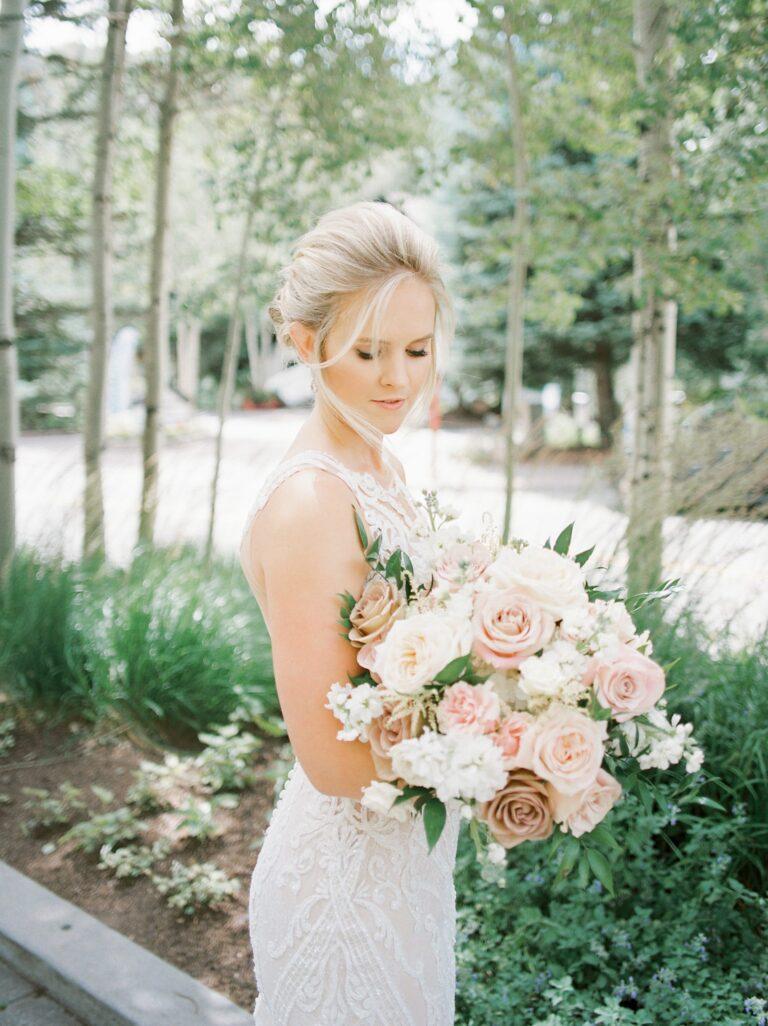 Bride holding a flower bouquet outdoors