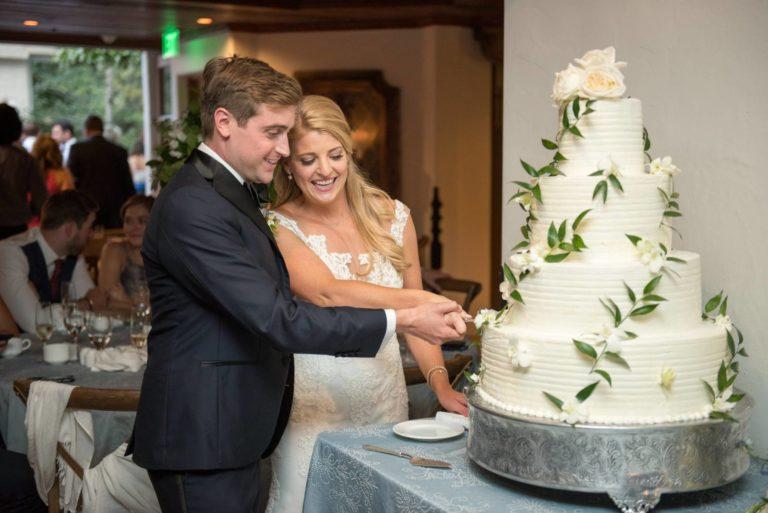 Brde and groom cutting cake