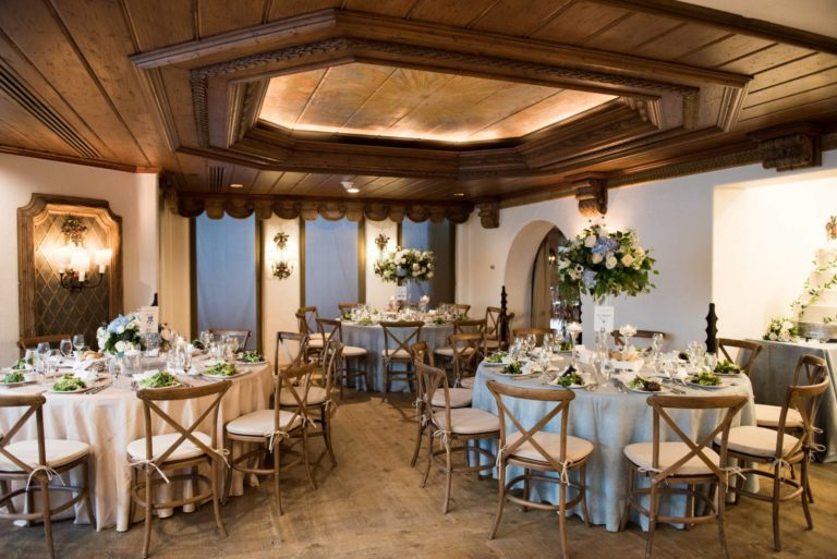 Reception area with tables with placesettings and centerpieces