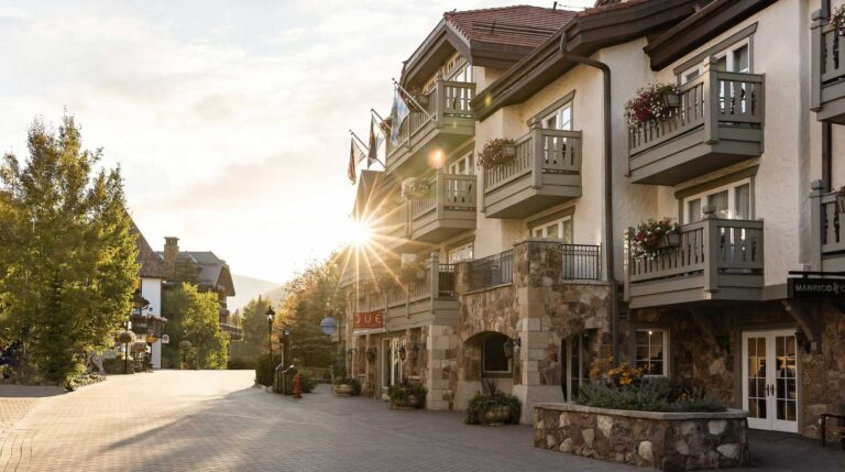 Sun shining behind the facade of Sonnenalp Hotel