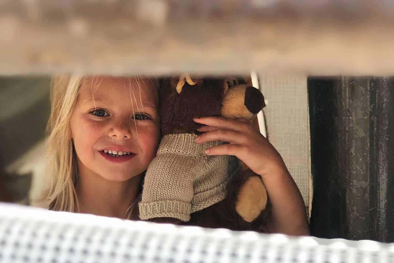 Sonnenalp-Activies-_0001_Kids Club little girl with bear