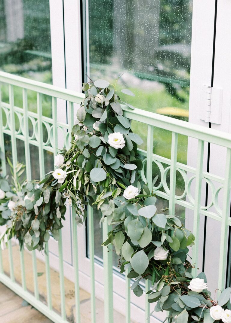 Metal railing decorated with plants