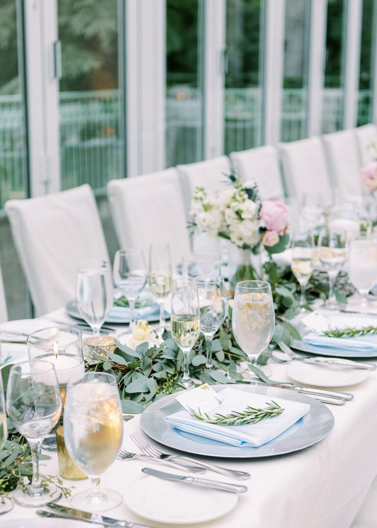 Closeup of long table with place settings