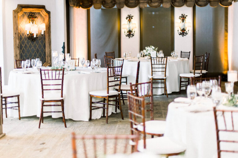 Reception area with tables, chairs, and placesettings