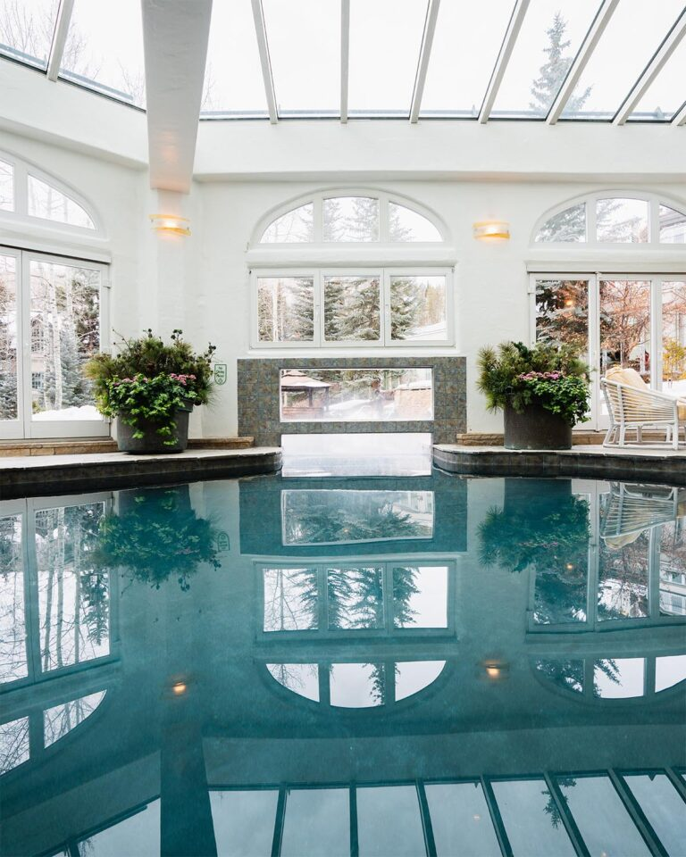 Indoor pool with skylights connected to outdoor pool