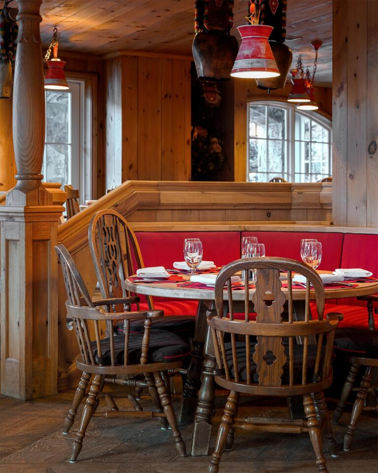 Restaurant booth and chairs and wooden walls