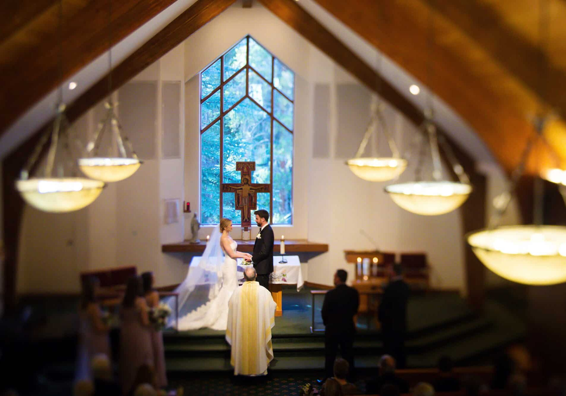 Bride and groom getting married in a chapel